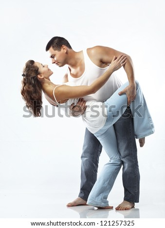 Portrait of beautiful athletic couple over light background - stock photo