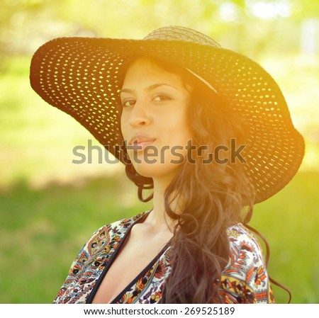 Portrait of beautiful attractive woman with straw hat - stock photo