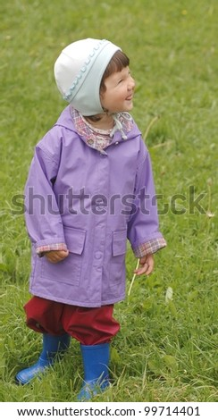 Portrait of beautiful baby after the rain - stock photo