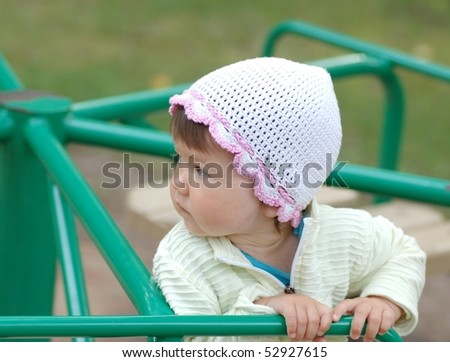 Portrait of beautiful baby girl on merry-go-round
