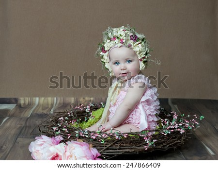 Portrait Of Beautiful Baby Girl Wearing Hat - stock photo