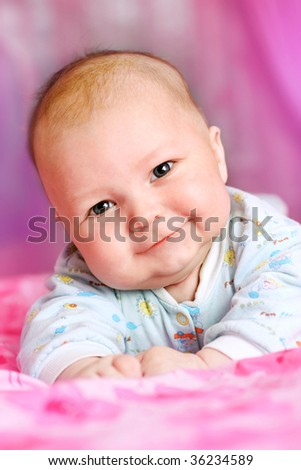 portrait of beautiful baby on pink background