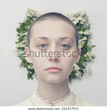 portrait of beautiful bald-headed girl over floral background - stock photo