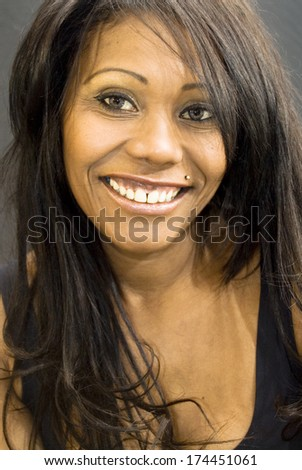 Portrait of  Beautiful Black Woman  over black background