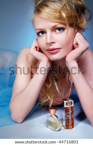Portrait of beautiful blond and sexy woman with perfume - stock photo
