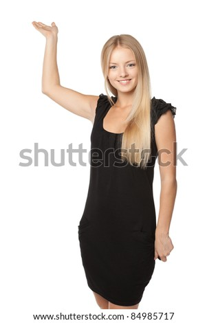 Portrait of beautiful blond business woman in black dress showing copy space placed upwards over white background - stock photo