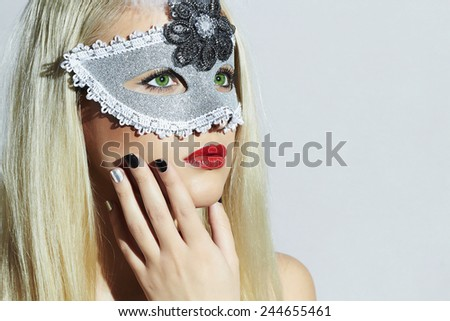 portrait of Beautiful Blond Woman in Carnival Mask.Masquerade.Young Girl with red lips.Manicure Shellac - stock photo