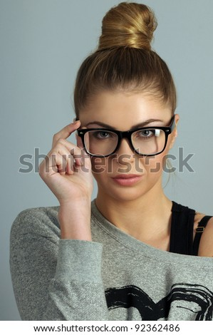 portrait of beautiful blond woman in glasses - stock photo