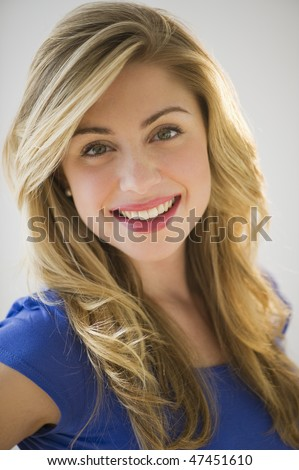 portrait of beautiful blonde female with hair light - stock photo