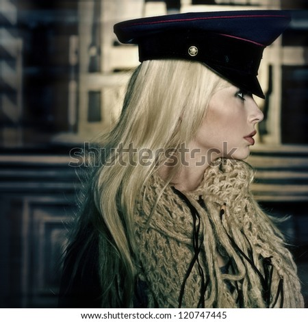 portrait of beautiful blonde girl in military cap - stock photo