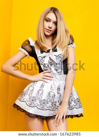 Portrait of beautiful blonde maid - stock photo