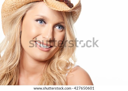 Portrait of beautiful blonde model with straw hat, isolated on white