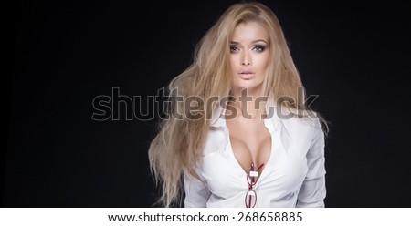 Portrait of beautiful blonde sexy woman in studio. - stock photo