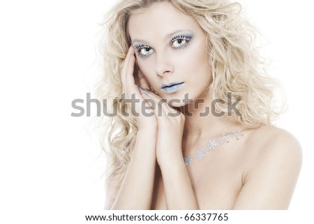 Portrait of beautiful blonde winter snow queen - stock photo