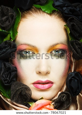 Portrait of beautiful blonde with a wreath of flowers on her head - stock photo