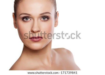 portrait of beautiful blonde with blue eyes on white background