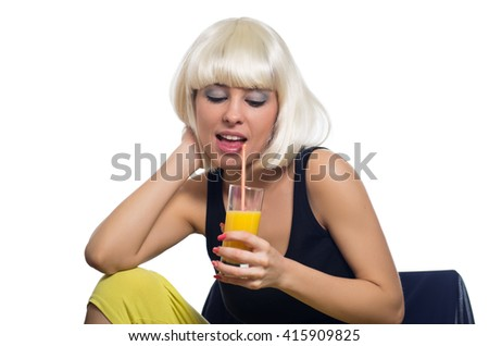 Portrait of beautiful blonde with with short hair drinking juice - stock photo