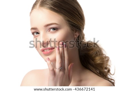 Portrait of beautiful blonde woman applying cream on her face. isolated on white - stock photo