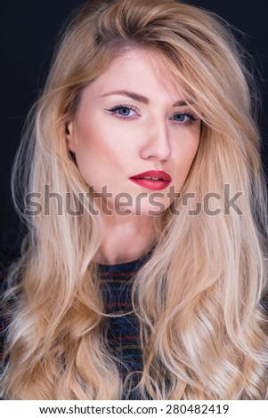 Portrait of beautiful blonde woman, focus on the eyes, shallow depth of field - stock photo