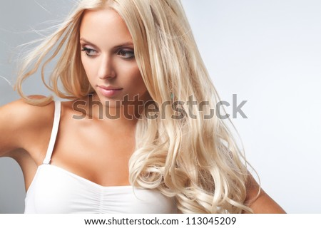 Portrait of beautiful blonde woman . Healthy Long Blond Hair. Hair Extension - stock photo