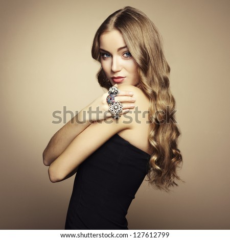 Portrait of beautiful blonde woman in black dress. Fashion photo - stock photo