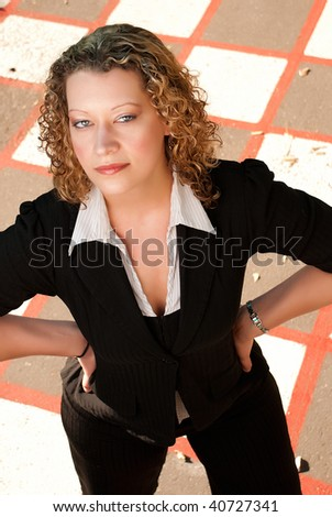 Portrait of beautiful blonde woman on checkered background - stock photo