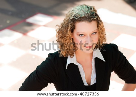 Portrait of beautiful blonde woman on checkered background