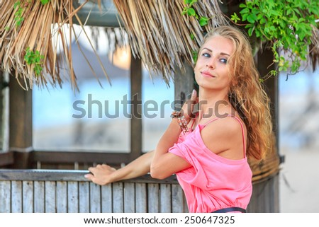 Portrait Of Beautiful Blonde Woman on the beach - stock photo