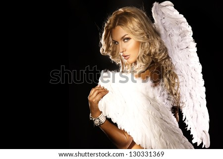 Portrait of beautiful blonde woman with angel's wings. Angel with long curly hair. - stock photo