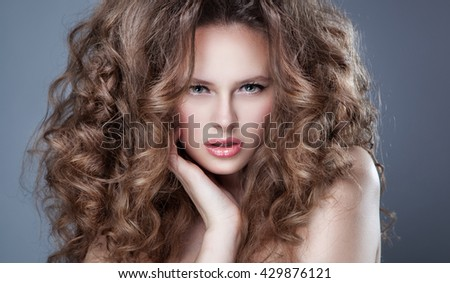 Portrait of beautiful blonde woman with curly hairstyle and bright makeup, perfect skin, skincare, spa, cosmetology. Sexy vogue woman face, sensual beauty girl model. Natural look. studio.