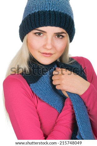 portrait of beautiful blonde young woman in cap and scarf. On white