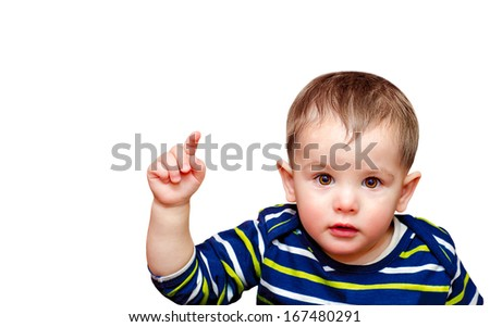 Portrait of beautiful boy pointing finger at camera - stock photo
