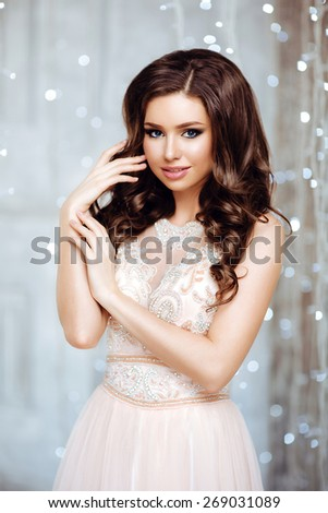 Portrait of Beautiful Bride in Lights. Fashion Dress and MakeUp. Beautiful White Bokeh. Close Up