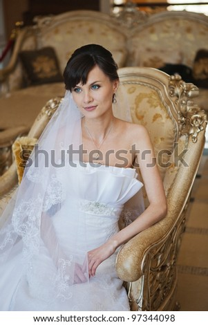 portrait of beautiful bride in luxury interior - stock photo