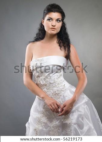 portrait of beautiful bride on grey background studio shot - stock photo