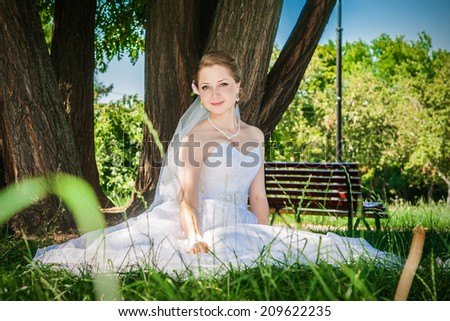 Portrait of beautiful bride outdoors