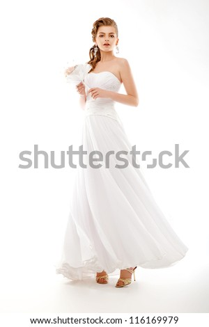 Portrait of beautiful bride. Wedding dress. Bridal bouquet of flowers - stock photo