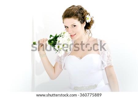Portrait of beautiful bride. Wedding dress. Wedding decoration, on white background - stock photo