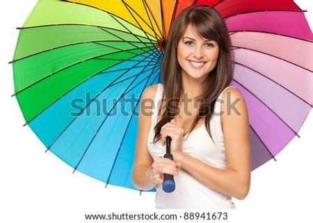 Portrait of beautiful brunette female standing under umbrella over white background - stock photo