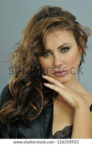 Portrait of beautiful brunette girl looking dreamy to the camera