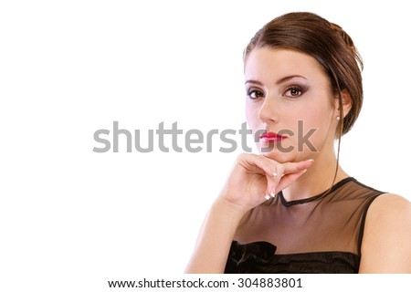 portrait of beautiful brunette girl posing in black cocktail dress on white - stock photo