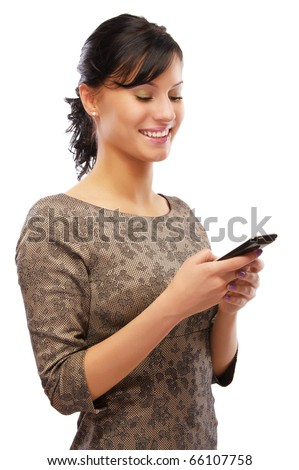 portrait of beautiful brunette with cellphone on white - stock photo