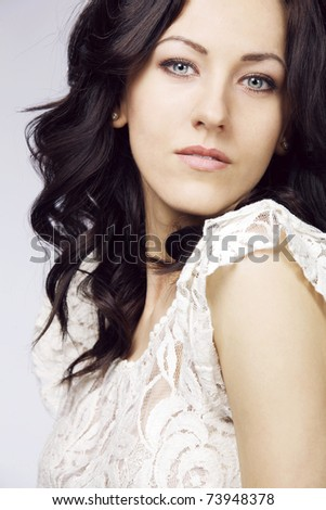 Portrait of beautiful brunette with long curly hair. - stock photo