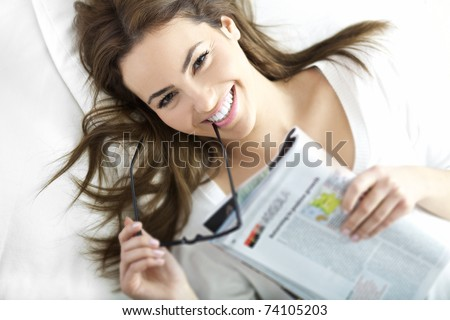 portrait of beautiful brunette with smile - stock photo