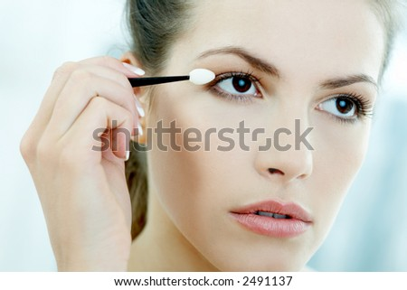 Portrait of Beautiful brunette woman doing daily morning routines (the make up series 2)
