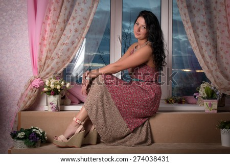 Portrait of beautiful brunette woman in a summer dress