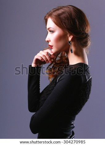 Portrait of beautiful brunette woman in black dress - stock photo