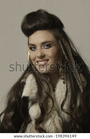 Portrait of beautiful brunette woman wearing tribal winter clothes and accessories
