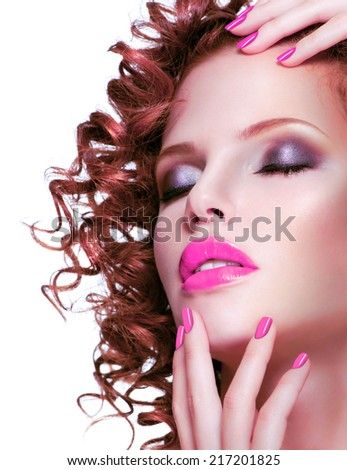Portrait of beautiful brunette woman with bright make up and manicure. Closeup face with curly hairstyle, isolated on white.