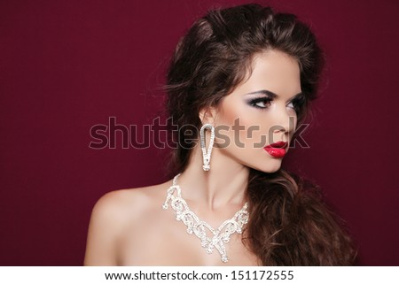 Portrait of beautiful brunette woman with diamond jewelry. Fashion photo - stock photo